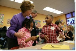 Laura Bush talks with Providence Family Support Center after-school program participants Isaiah Baynes, right, and Carlaija Whitehead during her visit and President Bush's to Pittsburgh to highlight the program's efforts to help area youth Monday, March 7, 2005.  White House photo by Susan Sterner