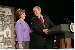 President George W. Bush and Laura Bush laugh as he introduces her during her remarks on Helping America's Youth at the Community College of Allegheny County in Pittsburgh Monday, March 7, 2005.  White House photo by Susan Sterner