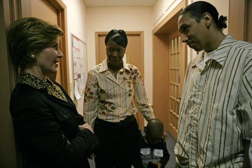 "Laura Bush speaks with Kenyatta ""Ken"" Thigpen, his girlfriend Jewell Reed and their three-year-old son, Kevion, during a visit to the Rosalie Manor Community and Family Services center in Milwaukee, Wis., Tuesday, March 8, 2005. Mrs. Bush credits a New York Times article by Jason DeParle about Mr. Thigpen's determination to be a responsible father with bringing her attention to the needs of boys and young men. White House photo by Susan Sterner"