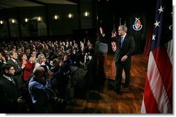 After delivering remarks about the War on Terror, President George W. Bush departs the National Defense University at Fort Lesley J. McNair in Washington, D.C., Tuesday, March 8, 2005.  White House photo by Eric Draper