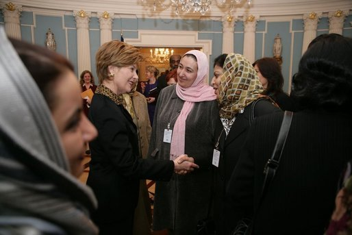 Laura Bush greets Afghan Ministers during her visit to the State Department for an International Women's Day Forum in Washington, D.C., Tuesday, March 8, 2005. White House photo by Susan Sterner