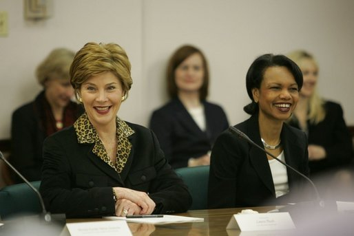 "Laura Bush and Secretary of State Condoleezza Rice laugh during a roundtable discussion with women leaders from around the world held in honor of International Women's Day at the State Department in Washington, D.C. Tuesday, March 8, 2005. Today in her remarks at the State Department Mrs. Bush said, ""We all have an obligation to speak for women who are denied their rights to learn, to vote or to live in freedom. We may come from different backgrounds, but advancing human rights is the responsibility of all humanity, a commitment shared by people of goodwill on every continent."" White House photo by Susan Sterner"