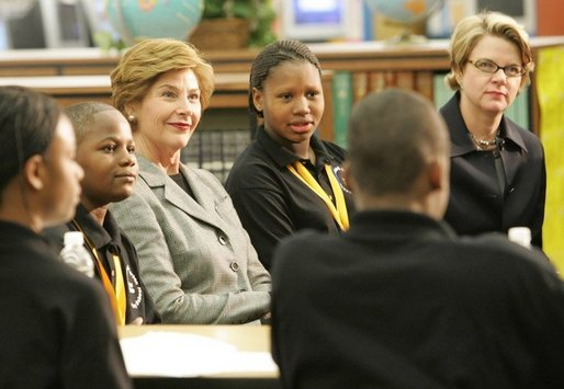 Laura Bush attends the Helping America's Youth Event at the Benjamin S. Carson Honors Preparatory School, Atlanta, Georgia, March 9, 2005, visiting a debate class with U.S. Education Secretary Margaret Spellings. White House photo by Susan Sterner