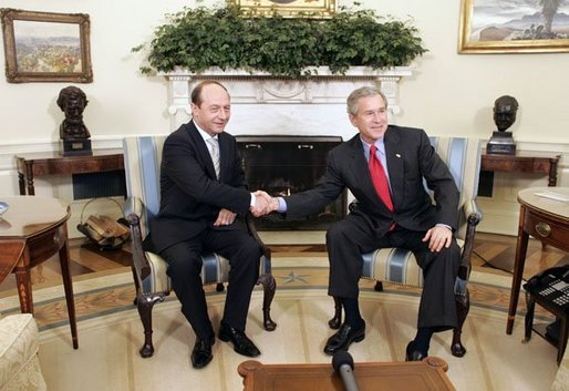 President George W. Bush welcomes Romanian President Traian Basescu to the Oval Office Wednesday, March 9, 2005. President Bush and President Basescu met to discuss regional security and diplomatic issues. White House photo by Paul Morse