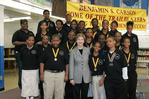 Laura Bush attends the Helping America's Youth Event at the Benjamin S. Carson Honors Preparatory School, Atlanta, Georgia, with debate class, March 9, 2005. White House photo by Susan Sterner