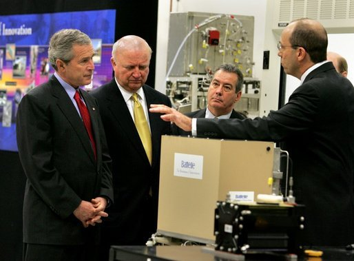 "President George W. Bush looks at a prototype for a fuel cell auxiliary power unit for the Bradley A3 fighting vehicle during a tour of the technology company, ""Battelle,"" with Energy Secretary Sam Bodman, left, vice president Bill Madia, center, and vice president Henry Cialone in Columbus, Ohio, Wednesday, March 9, 2005. White House photo by Krisanne Johnson"