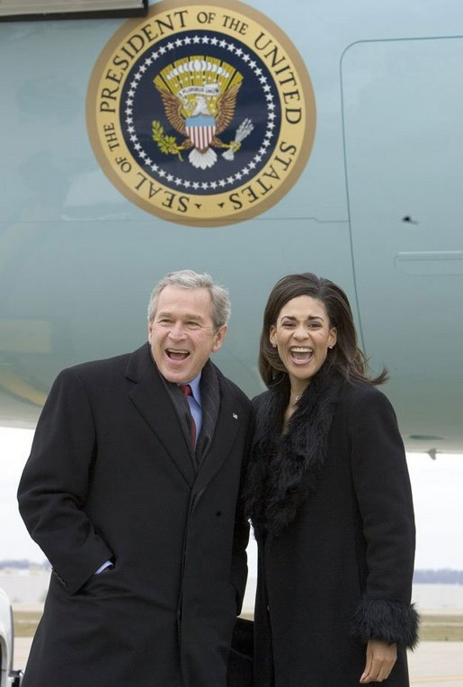 President George W. Bush laughs with USA Freedom Corps greeter Monica Hardin in front of Air Force One in Louisville, Ky., Thursday, March 10, 2005. White House photo by Paul Morse