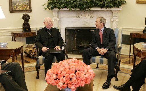 President George W. Bush talks with Bishop William Skylstad, newly elected president of the U.S. Conference of Catholic Bishops, in the Oval Office Monday, March 14, 2005. In November 2004, Bishop Skylstad was elected to a three-year term as head of the USCCB, which serves to promote, coordinate and encourage Catholic activities in the United States. White House photo by Krisanne Johnson