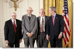 President George W. Bush awards the 2003 National Medal of Technology award to Corning Inc., scientists Ronald M. Lewis, left, Irwin Lachman, center, and Rodney D. Bagley, during a ceremony in the East Room, Monday, March 14, 2005.  White House photo by Paul Morse