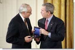 President George W. Bush presents the National Medals of Science and Technology during a ceremony in the East Room, Monday, March 14, 2005.  White House photo by Paul Morse