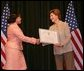 Laura Bush hands out awards at the Institute of Museum and Library Services (IMLS) ceremony, March 14, 2005 at the Hotel Washington in Washington, D.C. White House photo by Susan Sterner