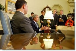 President George W. Bush and His Majesty King Abdullah of Jordan talk with reporters in the Oval Office Tuesday, March 15, 2004.  White House photo by Paul Morse