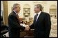 President George W. Bush welcomes Deputy Secretary of Defense Paul Wolfowitz to the Oval Office Wednesday, March 16, 2005. President Bush is recommending Secretary Wolfowitz to be elected as the next President of the World Bank. White House photo by Paul Morse