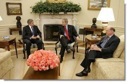 President George W. Bush meets with Deputy Secretary of Defense Paul Wolfowitz and Secretary of Treasury John Snow in the Oval Office Wednesday, March 16, 2005.  White House photo by Paul Morse
