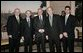 During St. Patrick's Day celebrations at the White House, President George W. Bush stands with, from left, Irish Prime Minister Bertie Ahern; British Ambassador Sir David Manning; British Secretary of State for Northern Ireland Paul Murphy; and U.S. Special Envoy for Northern Ireland Mitchell Reiss in the Diplomatic Reception Room Thursday, March 17, 2005. White House photo by Eric Draper