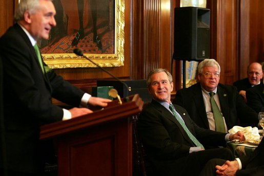President George W. Bush and Speaker of the House Dennis Hastert, right, listen to remarks by Irish Prime Minister Bertie Ahern during a St. Patrick's Day Luncheon at the U.S. Capitol Thursday, March 17, 2005. White House photo by Krisanne Johnson