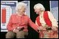 Former First Lady Barbara Bush speaks with Myrtle Campbell during a discussion on strengthening Social Security at Pensacola Junior College in Pensacola, Fla., Friday, March 18, 2005. White House photo by Eric Draper