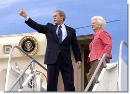 Before departing Pensacola en route Orlando, Fla., President George W. Bush gives a thumbs up sign while boarding Air Force One with his mother Barbara Bush Friday, March 18, 2005. White House photo by Eric Draper