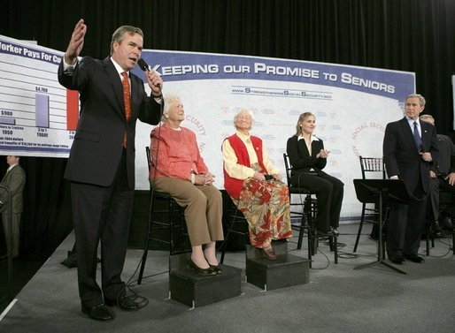 Photo.President George W. Bush listens to his brother Florida Governor Jeb Bush during a discussion about Social Security at Pensacola Junior College in Pensacola, Fla., Friday, March 18, 2005. Pictured, from left, are: Former First Lady Barbara Bush, Myrtle Campbell and her granddaughter Mary Beth Roberts. White House photo by Eric Draper