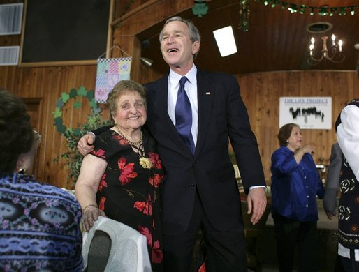 President George W. Bush visits with retirees at The Life Project Senior Development Center in Orlando, Fla., Friday March 18, 2005. White House photo by Eric Draper
