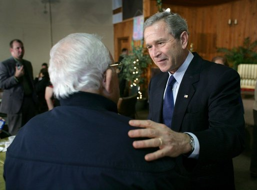 President George W. Bush talks with a retiree during a visit to The Life Project Senior Development Center in Orlando, Fla. Friday, March 18, 2005. White House photo by Eric Draper
