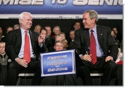 President George W. Bush and Senator John McCain, R-Ariz., participate on stage Monday, March 21, 2005, during a Conversation on Strengthening Social Security at the Wings Over the Rockies Air and Space Museum in Denver.  White House photo by Eric Draper