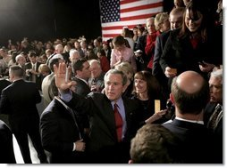 President George W. Bush waves to the crowd at the end of his 'Conversation on Strengthening Social Security' Monday, March 21, 2005, in Denver. The President took his plans for reform to an estimated 1,200 guests at the Wings Over the Rockies Air and Space Museum.  White House photo by Eric Draper