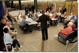 President George W. Bush talks about Social Security issues with a group of seniors Monday, March 21, 2005, at the Morris K. Udall Center in Tucson, Ariz. The recreation center was the president's first stop on his Arizona visit.  White House photo by Eric Draper