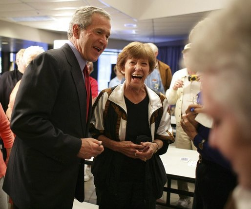 President George W. Bush shares a light moment with seniors at Tucson's Morris K. Udall Center during his early morning visit Monday, March 21, 2005. The president made the recreational center his first Arizona stop and spoke to seniors there about his plans for strengthening Social Security. White House photo by Eric Draper