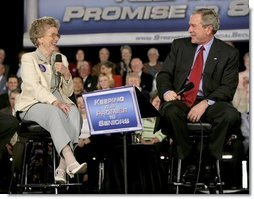 Tucson resident Mary-Margaret Raymond smiles as she speaks to President George W. Bush about Social Security issues during the president's visit to her home town Monday, March 21, 2005. The 84-year-old retired county administrator told the president that Social Security had become an important part of her retirement income and she had no fear that it would be impacted by reform.  White House photo by Eric Draper