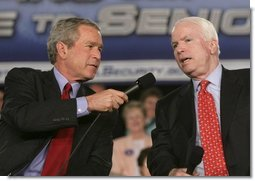 President George W. Bush shares the microphone with Senator John McCain, R-Ariz., as they speak to an audience at the Tucson Convention Center Monday, March 21, 2005, about strengthening Social Security.  White House photo by Eric Draper