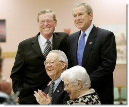 President George W. Bush and Senator Pete Domenici, R-NM., visit with breakfast guests at Bear Canyon Senior Center, Tuesday, March 22, 2005, in Albuquerque. The two visited with more than 30 seniors who were on hand to hear the president's proposals for Social Security reform.  White House photo by Eric Draper