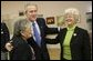 President George W. Bush greets Millie Martinez, right, and Ida Gonzalez at Bear Canyon Senior Center in Albuquerque, Tuesday, March 22, 2005, as he took his Conversation for Strengthening Social Security into New Mexico. The president reassured the approximately 30 breakfast guests that those born before 1950 will be unaffected by proposed reforms to the program. White House photo by Eric Draper