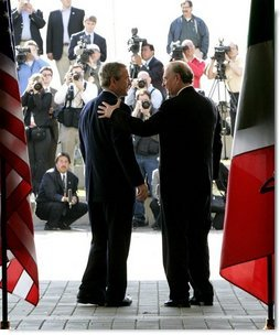 President George W. Bush greets Canadian Prime Minister Paul Martin at the beginning of meetings between the United States, Mexico and Canada at Baylor University in Waco, Texas, Wednesday, March 23, 2005.   White House photo by Eric Draper