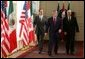 President George W. Bush walks with Mexico President Vicente Fox, left, and Canadian Prime Minister Paul Martin upon their arrival Wednesday, March 23, 2005, at the Bill Daniels Activity Center at Baylor University in Waco, Texas. White House photo by Eric Draper