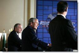 President George W. Bush smiles during a joint press conference Wednesday, March 23, 2005, after talks with Canada's Prime Minister Paul Martin, left, and Mexico's President Vicente Fox at the Bill Daniels Activity Center on the campus of Baylor University in Waco, Texas.   White House photo by Krisanne Johnson