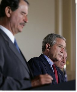 "President George W. Bush participates in a March 23, 2005, joint news conference with Mexican President Vicente Fox, left, and Canadian Prime Minister Paul Martin, right, at Baylor University in Waco, Texas. ""It's important for us to work to make sure our countries are safe and secure, in order that our people can live in peace, as well as our economies can grow,"" said President Bush.  White House photo by Krisanne Johnson"