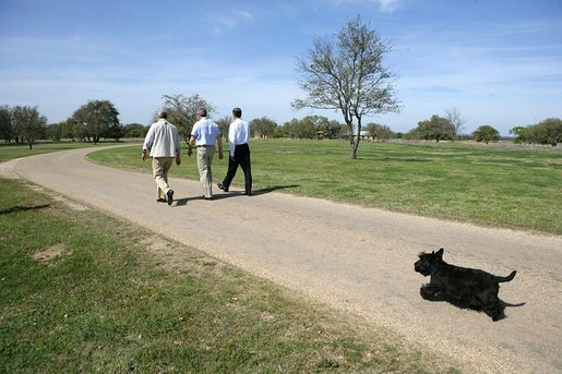 As Barney follows along, President George W. Bush walks with Canadian Prime Minister Paul Martin, left, and Mexican President Vicente Fox in Crawford, Texas, March 23, 2005. White House photo by Eric Draper White House photo by Eric Draper