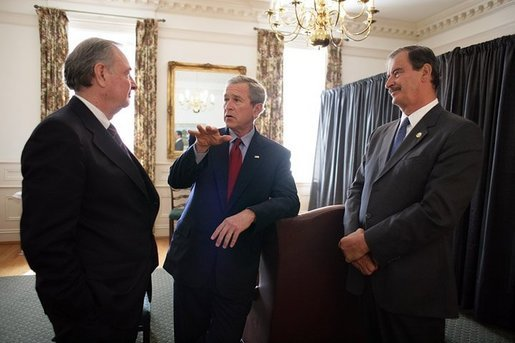 President George W. Bush talks with Canadian Prime Minister Paul Martin, left, and Mexican President Vicente Fox, right, during their March 23, 2005, trilateral meeting at Baylor University in Waco, Texas. White House photo by Eric Draper White House photo by Eric Draper