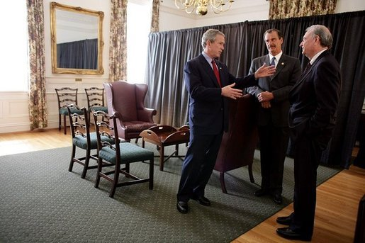 President George W. Bush talks privately with Mexican President Vicente Fox, center, and Canadian Prime Minister Paul Martin, right, during a March 23, 2005, trilateral meeting at Baylor University in Waco, Texas. White House photo by Eric Draper White House photo by Eric Draper