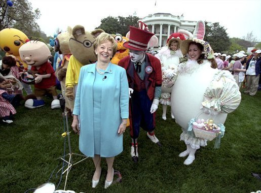 "Accompanied by all sorts of story book characters, Lynne Cheney the host of the 2003 White House Easter Egg Roll, addresses the media on the South Lawn Monday, April 21, 2003. ""But most of all, we are proud of all of you, the men and women who serve our country, who keep our country free,"" said Mrs. Cheney in her opening remarks welcoming U.S. military families to the event. File Photo. White House photo by David Bohrer"