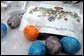 Rain swirls with Easter Egg dye to create intricate patterns on a few of the more than 10,000 eggs prepared for the White House Easter Egg Roll.White House photo by Courtney Bowers