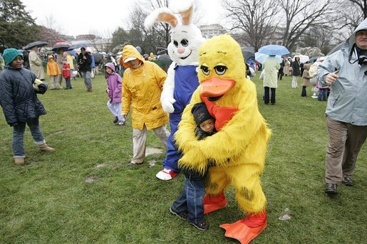 Cold days bring warm hugs as the Easter Bunny and his friends greets young visitors to a soggy South Lawn the 2005 White House Easter Egg Roll. White House photo by Paul Morse
