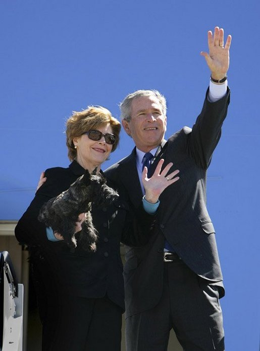 Mrs. Bush holds onto Miss Beazley Monday, March 28, 2005, as she and President George W. Bush wave goodbye upon boarding Air Force One in Waco, Texas, en route home to Washington D.C. White House photo by Eric Draper