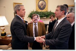 Meeting with citizens from Iraq, President George W. Bush talks with Maurice Shohet and Ali Alattar, center, in the Oval Office Tuesday, March 29, 2005.  White House photo by Eric Draper