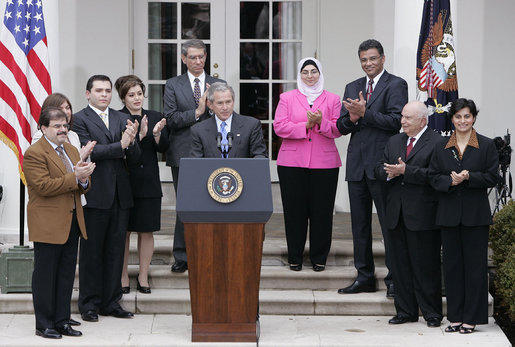 "Accompanied by Iraqi citizens who voted in the recent elections, President George W. Bush delivers remarks about freedom in Iraq in the Rose Garden Tuesday, March 29, 2005. ""I want to thank you for your strong belief in democracy and freedom. It's a belief that, with their vote, the Iraqi people signal to the world that they intend to claim their liberty and build a future of freedom for their country,"" said President Bush. ""And it was a powerful signal."" White House photo by Eric Draper"