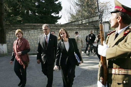 Laura Bush arrives at the Presidential Palace accompanied by U.S. Ambassador to Afghanistan Zalmay Khalilzad and Under Secretary of State for Global Affairs Paula Dobriansky in Kabul, Afghanistan Wednesday, March 30, 2005. White House photo by Susan Sterner