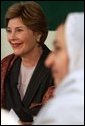 Laura Bush listens to the comments of Afghan teachers and students during a roundtable at the Women's Teacher's Training Institute of Kabul University in Kabul, Afghanistan, Wednesday, March 30, 2005. White House photo by Susan Sterner