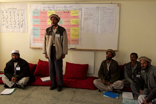 A man studying to be a teacher stands to introduce himself during a visit by Mrs. Bush to Kabul University in Kabul, Afghanistan, Wednesday, March 30, 2005. White House photo by Susan Sterner