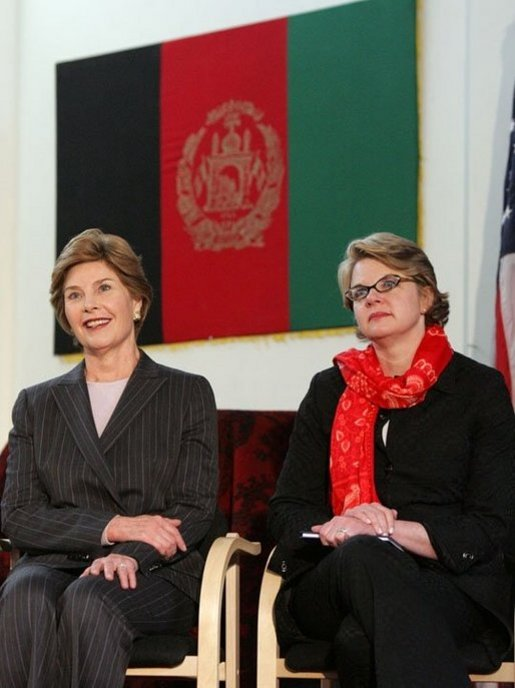 Laura Bush and U.S. Secretary of Education Margaret Spellings are seated together onstage at Kabul University Wednesday, March 30, 2005 in Kabul, Afghanistan. Mrs. Bush and Secretary Spellings toured the Women's Teacher's Training Institute and the National Women's Dormitory prior to Mrs. Bush's announcement of the United States' commitment to provide more than 15 million dollars in funds for building a new university in Kabul. White House photo by Susan Sterner